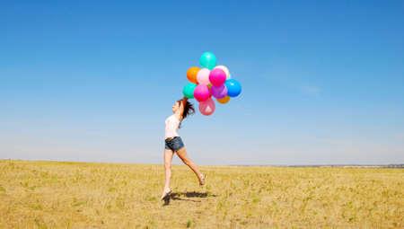 Spring meisje met ballonnen  Stockfoto