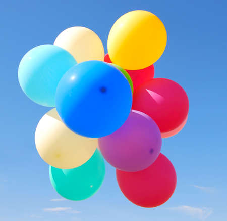 colorful balloons over sky background photo