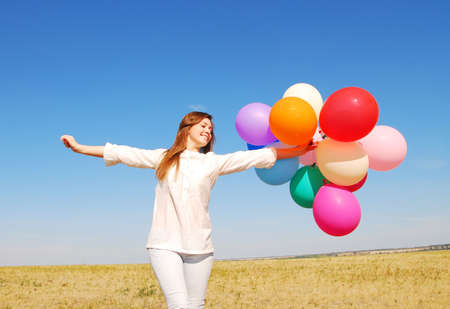 freedom leisure activity: young happy woman with balloons
