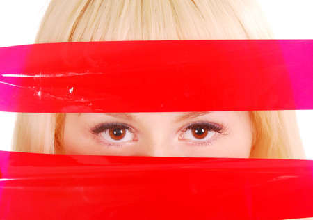 eyes looking through red ribbons photo