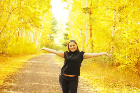 happy woman in the autumn forest photo