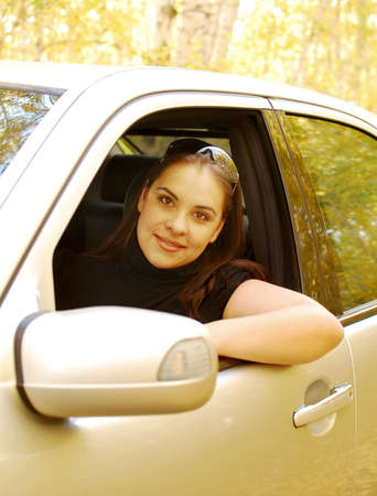 young pretty woman in her car photo