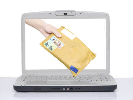 hand with envelope comes from laptop screen Stock Photo