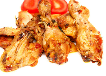tasty roasted pieces of chicken on white photo