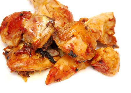 tasty roasted pieces of chicken on white Stock Photo - 9308440