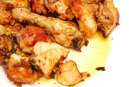 tasty roasted pieces of chicken on plate photo