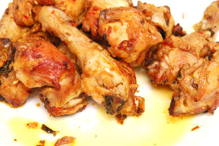 tasty roasted pieces of chicken on white Stock Photo - 9334158