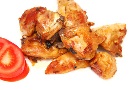 tasty roasted pieces of chicken on white Stock Photo - 9366070