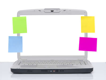 tiedup: laptop with post it on the screen isolated on white