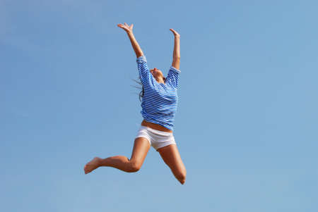 jumping woman against sky background photo