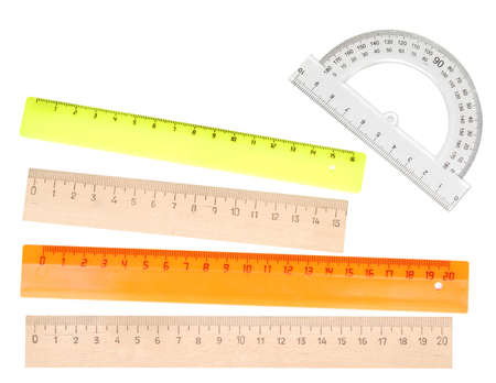 wooden and plastic rulers isolated on white