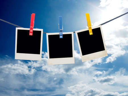 photo frames on a rope against sky background photo