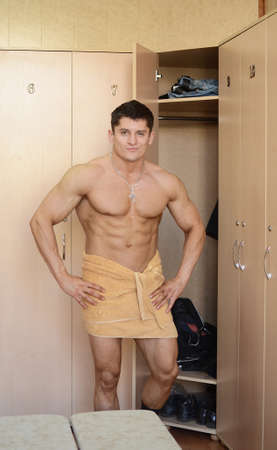 muscular perfect male in locker room photo