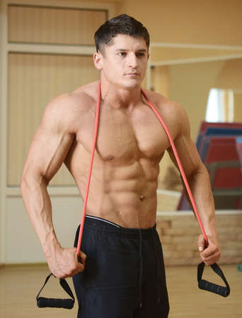 muscular perfect male in a gym center photo