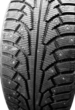 new winter tire with stud isolated on white photo