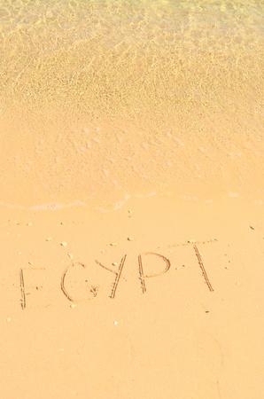 exotism: word Egypt written on sand