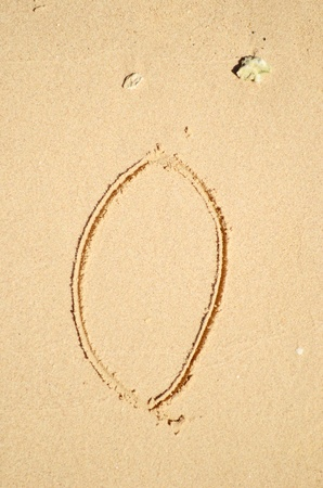 number zero written on the sand photo