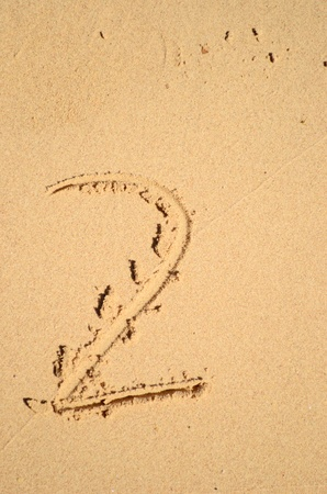 number two written on the sand photo