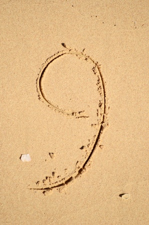 number nine written on the sand photo