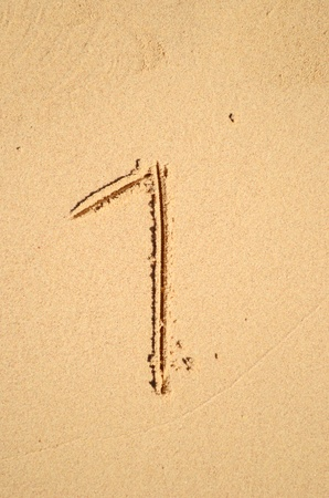 number one written on the sand photo