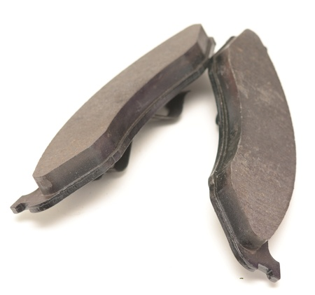 two brake pads on white photo