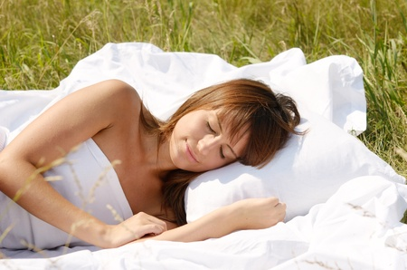 sleeping woman on green grass photo