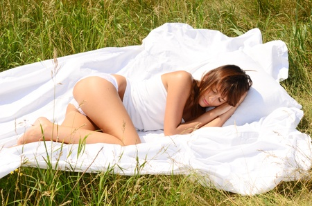 sleeping beautiful woman on grass photo