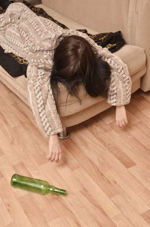 alcoholic beverages: drunk woman sleeping on the sofa