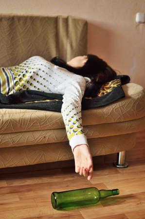 drunk girl: drunk woman sleeping on the sofa