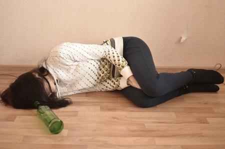 drunk woman lying on the floor photo