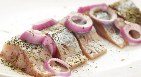 boned: salted herring on the plate with red onion