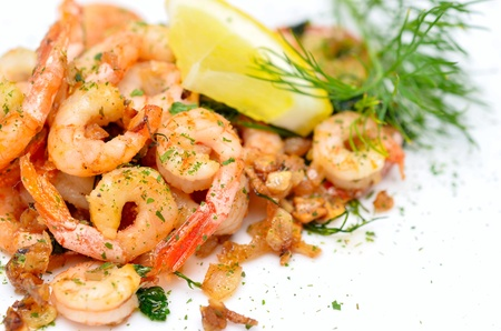 seafood salad: fried shrimps with garlic and fresh dill Stock Photo