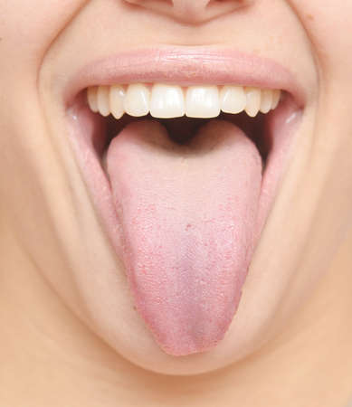 close up of healthy woman tongue Stock Photo