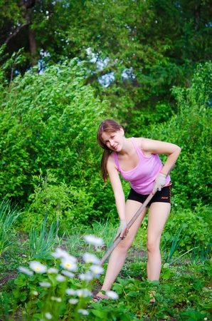 young happy woman working in the garden photo