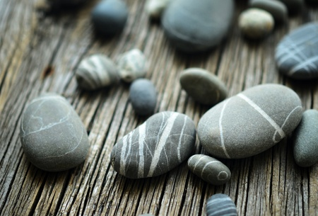 pebbles on wooden background photo