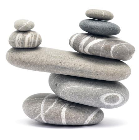 harmony united: balancing stones isolated on white background