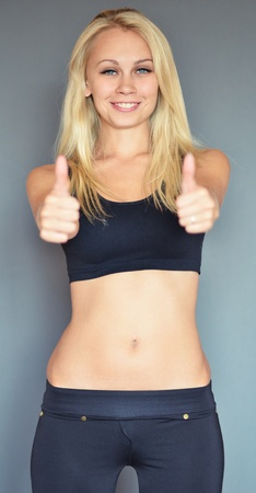 young slim woman showing thumbs up