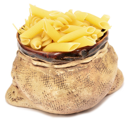 raw pasta in a bowl on a white background photo