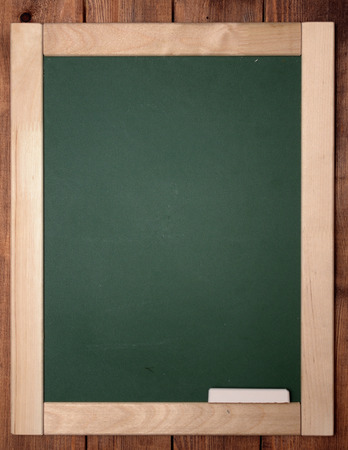 blackboard with chalk on wooden background photo