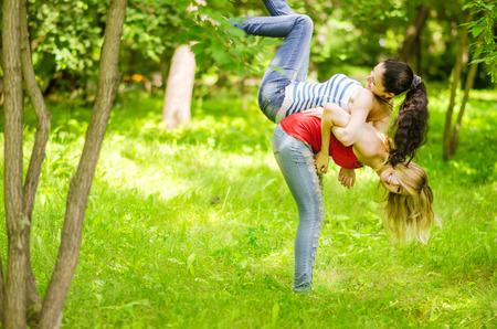 two young girls having fun outdoor photo