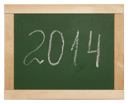 2014 written on blackboard isolated on white photo