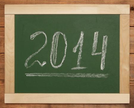 2014 written on blackboard Stock Photo - 26363962