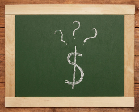 dollar sign and questions on blackboard photo