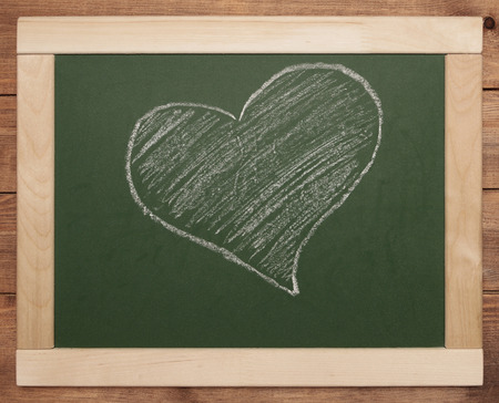 heart symbol on green blackboard photo