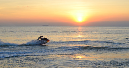 water  skier: jet sky and sunset