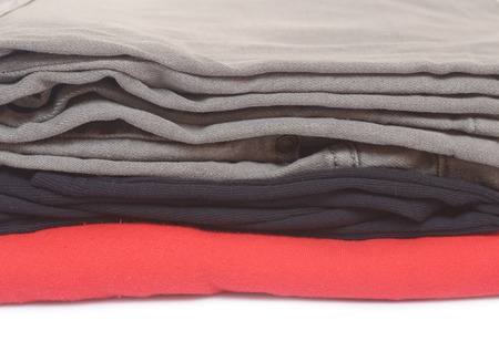 pile of clothes isolated on white background photo