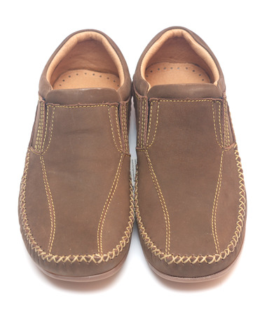 moccasins: pair of leather men shoes on white background Stock Photo