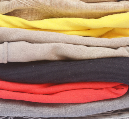 close up of folded color clothes photo