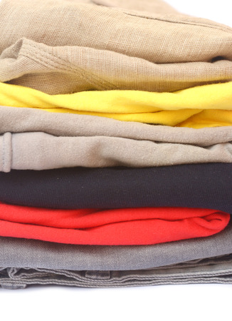 pile of color clothes on white background photo