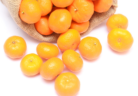 cleave: tangerines and sack isolated on white background